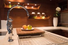 of the Day: While wood is not safe to use behind a cooking surface, and is too sensitive to moisture, a wood backsplash can provide a warm appearance in moisture-free/heat-free areas of the kitchen. More Backsplash Ideas. Dark Wood Kitchen Cabinets, Dark Wood Kitchens, Kitchen Shelves, Kitchen Colour Schemes, Kitchen Colors, Retro Kitchen Decor, Kitchen Design, Wood Backsplash, Backsplash Ideas