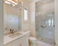 New Construction Beach House with Coastal Interiors.  Basement Bathroom