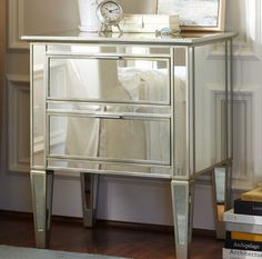 I love mirrored furniture like this.