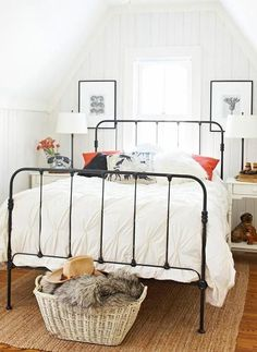 black iron bed and white bedding