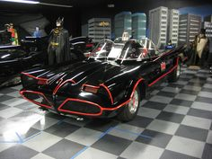 Collection of Batmobiles, including the 1966 Batmobile (with Bat-Scope antenna retracted)