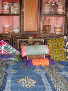 Glitzy bedouin tent interior in desert of Oman.