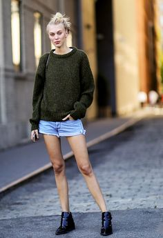 Crew neck sweater, denim shorts, and black ankle boots