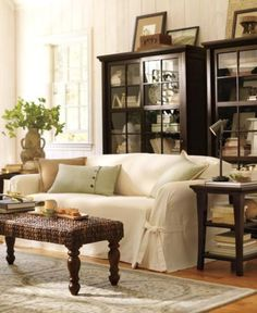 Beautiful Living Room & love the glass cabinets...... Pottery Barn