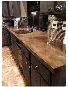 Dont be seduced by granite and other natural stone when choising a coutertop. concrete coutertop's look just as pretty and cost a fraction of the price. No seams!