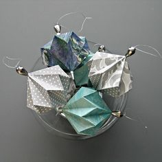 If you're looking for inexpensive handmade party decorations that you'll be proud to display long after your event is done, these origami ornaments certainly fit the bill. I love the so…