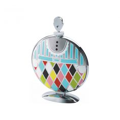 Fatman was designed by Marcel Wanders who has focused his attention on the object's decoration, creating a kind of colourful suit in which to dress the cake stand. This aspect makes the object versatile: closed, it is a table sculpture
