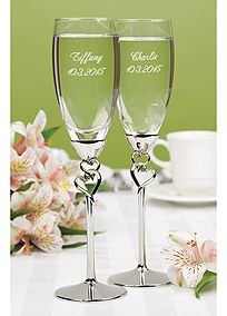 Two become one with these entwined hearts toasting flutes. Each heart features a clear rhinestone for a special added touch. Flutes are personalized with two lines of personalization such as bride's name and wedding date on one flute and groom's name and wedding date on the other flute.
