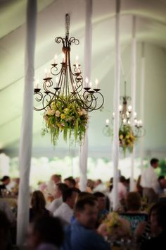 wrought iron chandelier with flowers in tent. I love these, very beautiful. DW