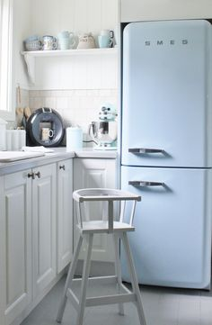 In honor of Pantone's 2016 colors of the year rose quartz and serenity blue kitchen refrigerator, appliances and dishware.