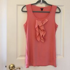 "ANN TAYLOR Salmon ruffled loose fitting top SIZE M ANN TAYLOR : Gorgeous Salmon loose fitting 27"" long sleeveless-top. Large silk like decorative ruffled detail down the front, in very soft 96% Rayan, 4% Spandex, soft machine washable, light weight fabric. Looks beautiful under a suit jacket or with a sweater . Wonderful condition ! Ann Taylor Tops Tank Tops"