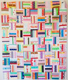 a quilt is nice: scrappy strips