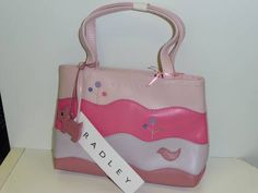 Brand new with tags cute Radley bag only 60quid @revelarefashion