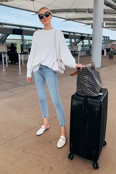 Fashion Jackson Wearing Free People White Tunic Sweater Levis High Rise Jeans White Gucci Muules White Chanel Handbag Calpak Luggage Goyard Tote Airport Outfit Travel Outfit