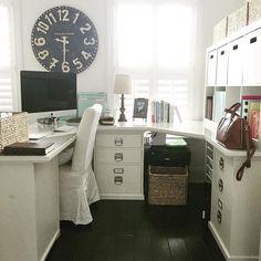 Home office white u-shaped desk. corner desk from pottery barn. ikea shelf with bins