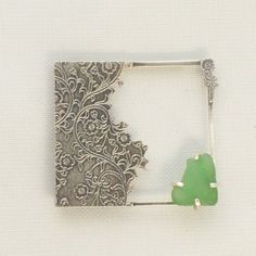 Sterling Silver Brooch with etched flower design and claw-set  green sea glass