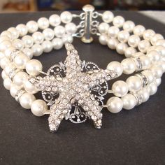 Triple Strands Pearl and Crystal Bracelet Rhinestone by luxedeluxe.  Great for a beach or nautical wedding.