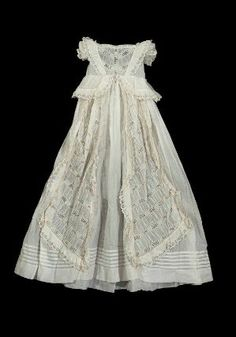 White cotton christening dress with eyelet embroidery, German, 1859. Worn by Prof. Harold North Fowler as an infant.