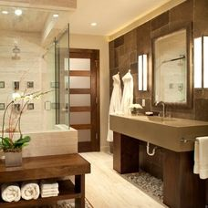 Awesome bathroom...love the river rock under the vanity and bench! Great shower enclosure and frosted glass in the door.   www.franksglass.com