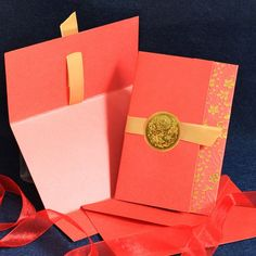 Chinese Traditional Elegant invitation card with a golden badge tied with a nice ribbon and nice patterns arround-W009I