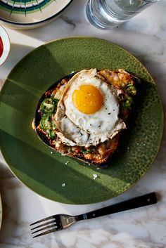NYT Cooking: This spicy egg-and-cheese on toast has its roots in the social-club circuit of Mumbai, though chefs in London, New York and Oakland have riffed on it recently, too. The dish is quick and simple, ideal for breakfast or a hearty snack between meals, and can be customized with a variety of cheeses and toppings. To make this updated Eggs Kejriwal, toast good bread and sm...