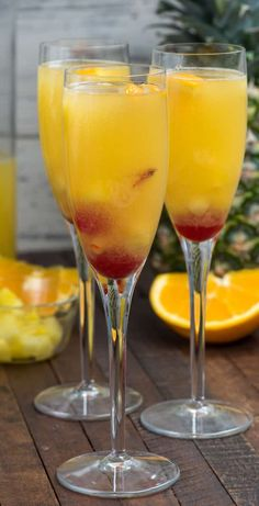 Hawaiian Champagne Punch is an easy mimosa recipe full of pineapple and orange juice and rum! It's the perfect party punch recipe!