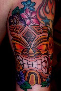 Hawaiian Tiki N Flowers Tattoo Designs - http://tattoosaddict.com/hawaiian-tiki-n-flowers-tattoo-designs.html #Designs, #Flowers, #Hawaiian, #HawaiianTattoo, #HawaiianTattoos, #N, #Tattoo, #Tiki