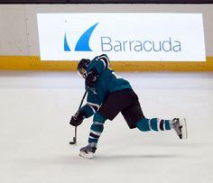 San Jose Sharks defenseman Dan Boyle bends his stick on a shot on goal attempt during the second period (Oct. 8, 2013).