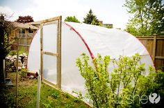 Looking for a way to reuse your kids' old toys? This trampoline was transformed from one backyard accessory into a completely new (and amazing!) greenhouse structure.