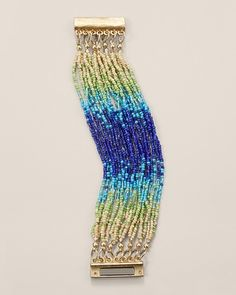 Blues fest: a festival of color and golden shimmer on a beaded bracelet.