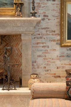 reclaimed materials - old thin brick and `limed` stonework - a perfect foil for a beautiful fireplace