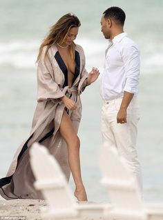 Model couple: Chrissy Teigen and John Legend took part in a stylised photo shoot on Miami ...  love the reptile kimono