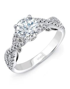 Round diamond solitaire engagement ring in 14K white gold, designed to fit a 6.5 mm center, with 42 round brilliants U-pave set along the halo and in two rows down the infinity | Uneek | https://www.theknot.com/fashion/a102w-65rd-uneek-fine-jewelry-engagement-ring