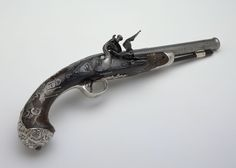 1730 British Flintlock pistol at the National Maritime Museum, London - Note the intricate silver filigree on the butt.