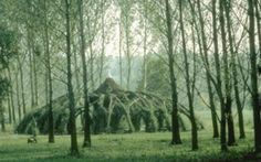 Auerworld Palace (1998), near Weimar, Germany, by architect Marcel Kalberer and his group Sanfte Strukturen. Woven saplings form a domed cathedral space. Terrific post at link. Also see pith+vigor. ty, Contemporary Basketry: Living Willow. via joernwryanbolosteros