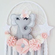 Elegant Elephant Dream Catcher With lovely felt flowers and sparkly stars. #dreamcatcher #dreamcatchers #handmade #handmadedecor #australianhandmade #elephantdecor #elephant #wallhanging #feltflowers #babydecor #babygift #babynursery #mumsinbusiness #mumswithhustle