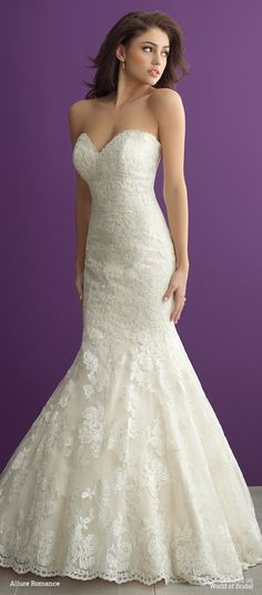 Just above the knee, this structured lace gown flares to a gorgeous tiered train.