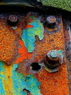 successive layers of paint enabling and revealing rust                                                                                                                                                                                 More