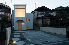 moon house by fumiaso architecture; designed around circular margins of undefined space