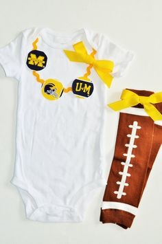 Check out this cool item I found!!!! University of michigan onesie Michigan Wolverines by RYLOwear
