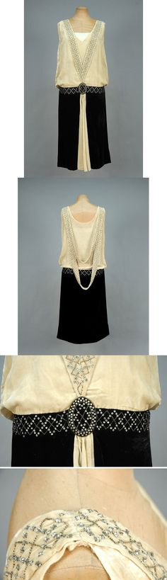 Panne velvet evening dress with rhinestones, 1920s. Bone silk sleeveless bodice having V-shaped band with diamond lattice of prong-set rhinestones and crystal beads terminating in black oval set in studded waistband of black skirt with cream center gore, back draped with two beaded swags. B-44, low W-40, L-46. $270