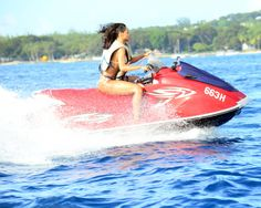 http://dailycaller.com/2015/07/10/9-beautiful-photos-of-rihanna-in-the-water-slideshow/rihanna-rides-around-in-a-bikini-on-jet-ski-at-beach-at-barbados