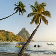 Here's one of our favourite pics, taken at Soufriere Bay in St Lucia with Petit Piton, the smaller of its two famous peaks, in the distance. 'Anyone heading down the west coast is bound to come face-to-face with them - two giant cones of rock that have watched the sun set over the Caribbean every day for the last 10,000 years' // photo by Justin Foulkes in our Dec '14 Caribbean Great Escape (at St Lucia)