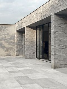 Facade Detail - Petersen Brick / Marc Merckx Interiors