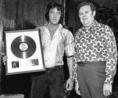 "Receiving award for the LP ""As Recorded at Madison Square Garden"" in Las Vegas - August 1, 1972. Elvis with George Parkhill."