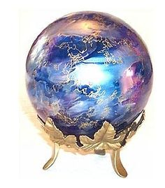 Witch ball on stand.