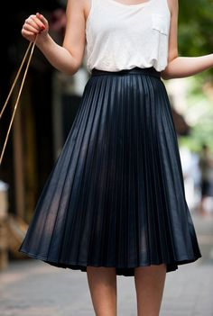 Pleated skirts always add a touch of feminine sophistication.