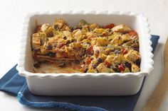Fresh veggies team up with lots of delicious stuff in this Mexican Chicken Casserole, including  black beans, whole wheat tortillas and melty cheese.