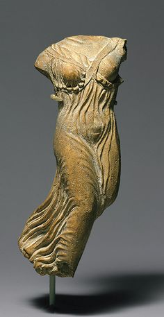 Torso of draped, flying Greek   The Metropolitan Museum of Art  Statuette of Nike (personification of victory), late 5th century B.C.; Classical  Greek  Terracotta  Source: http://www.metmuseum.org/toah/works-of-art/07.286.23#