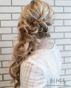 Long Curly Ponytail With A Braid